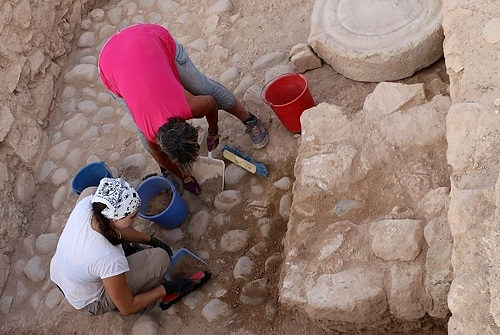 """In this photo provided from the Department of Antiquities of Cyprus, on Wednesday, Aug. 14, 2019, Archeologists work at the archeological site area during the 2019 excavation season at Kouklia outside in southwest city of Paphos, Cyprus. Archaeologists say the discovery of a small clay shard inscribed with a partial inventory of goods at a 2,500 year-old citadel suggests that Cyprus' ancient city states """"more than likely"""" had a homegrown, common economic management system. (Department of Antiquities of Cyprus via AP)"""