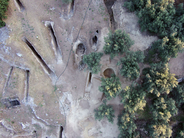 Aerial view of the road and the chamber of the two tombs in the eastern part of the  Mycenaean cemetery at Aidonia, along with the tombs from the old excavation  [Credit: Ephorate of Antiquities of Corinth]