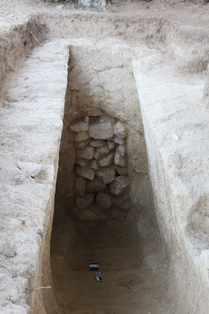The dromos and sealed entrance of the newly excavated tomb  [Credit: Ephorate of Antiquities of Corinth]