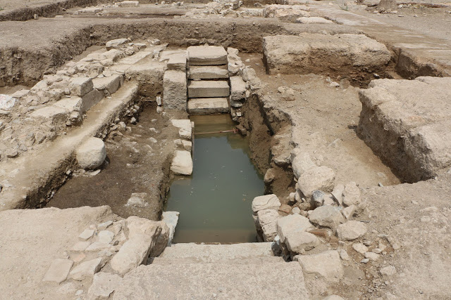 Underground fountain of Roman times, consisting of material from earlier monuments,  such as inscribed Hellenistic statue bases [Credit: Hellenic Ministry of Culture]