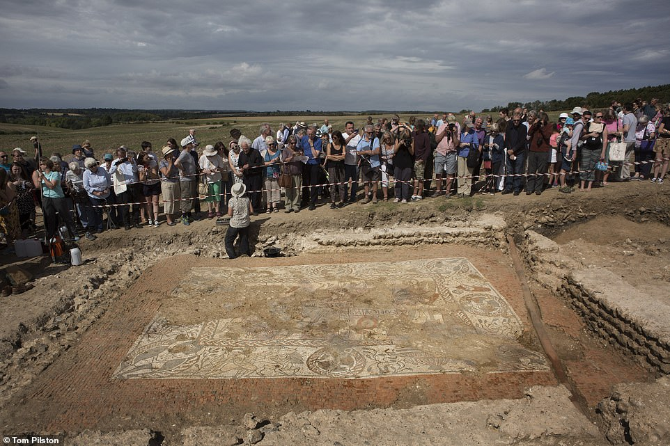 Members of the public crowded in a field in Boxford, Berkshire, to admire the 1,600-year-old Roman mosaic named the Bellerophon Mosaic. The finding depicts a chariot race involving Greek mythological figure Pelops, who is racing to win the hand of love interest Princess Hippodamia