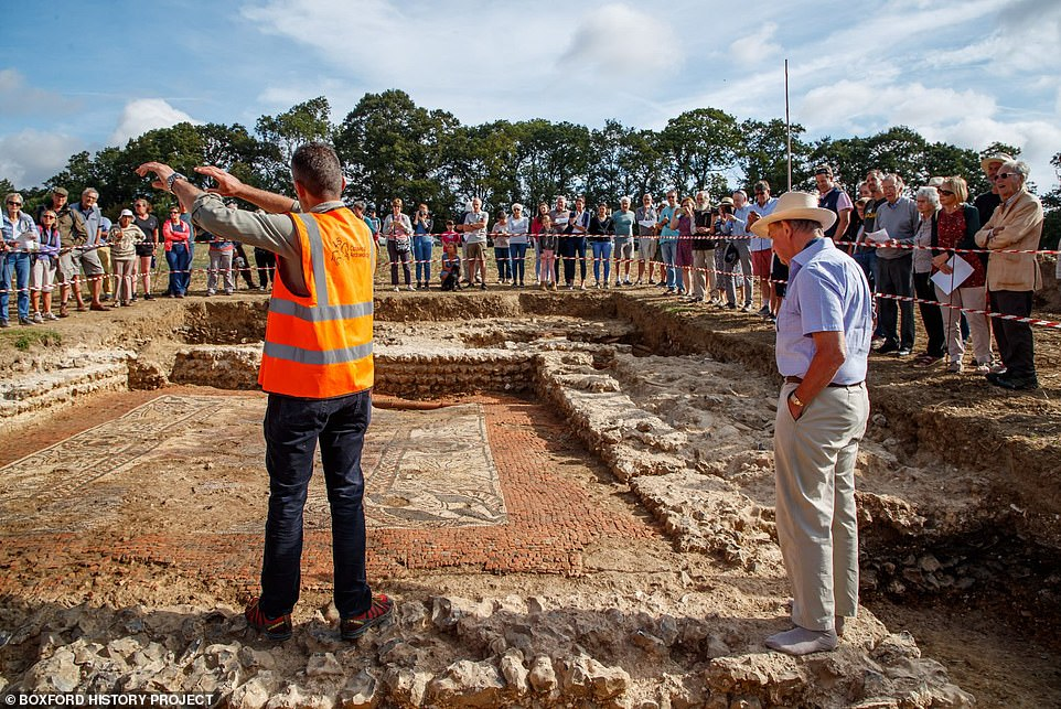 Two members of the team uncovering the Roman mosaic explain to the public who have come to see the 1,600-year-old mosaic