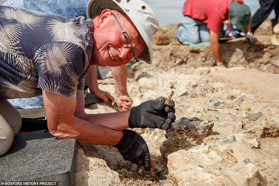 Those who worked on the dig were mainly volunteers from the Boxford History Project (above: a volunteer at the site uncovers an artefact)
