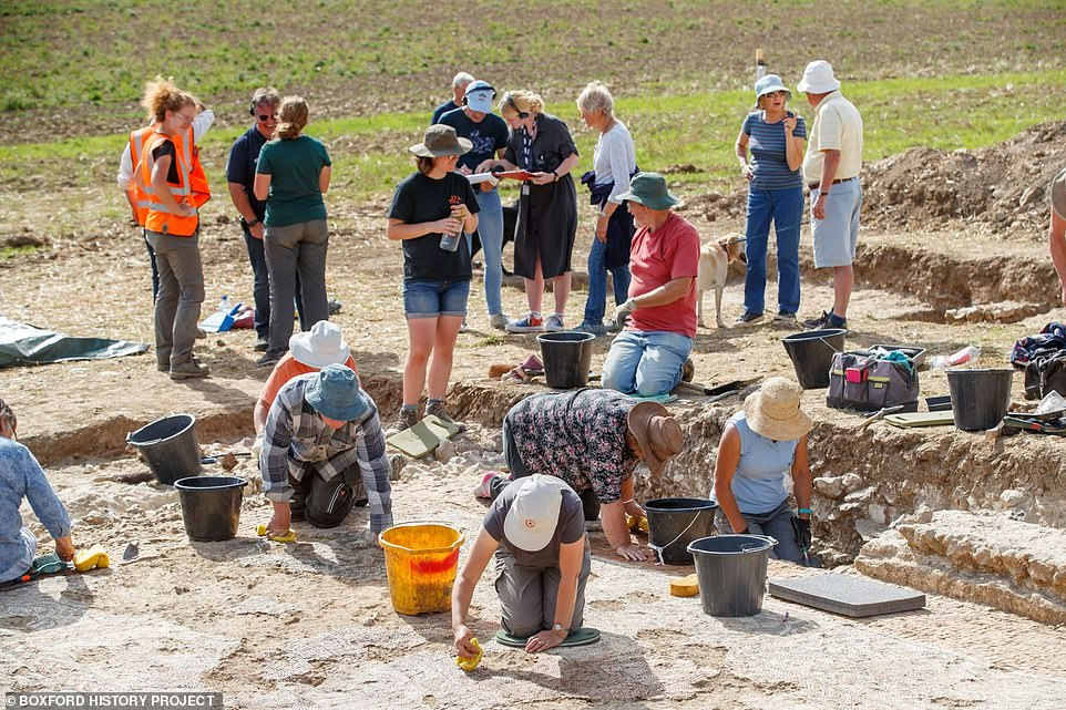 Joy Appleton, the group's chairman, told MailOnline: 'In 10 days only, the volunteers managed to clear the entire mosaic area. 'We have a passion for understanding our heritage and this is totally unknown in Britain. It is a rare thing'. Above: Boxford History Project volunteers work on uncovering the mosaic