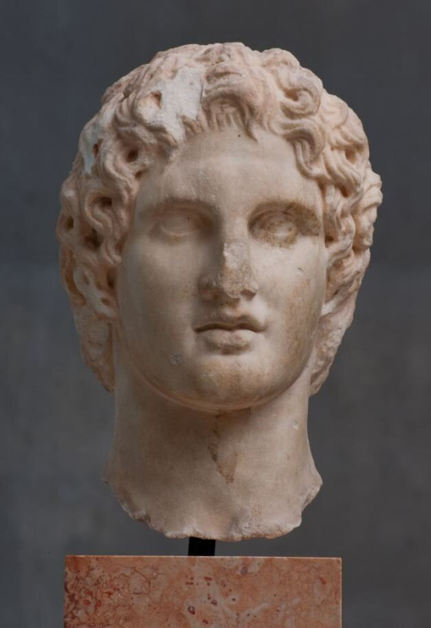 Head of Alexander, found near the Erechtheion of the Athens Acropolis in 1886.    Thought to be an original work of the sculptor Leochares, made around 330 BC.    Acropolis Museum, Athens.
