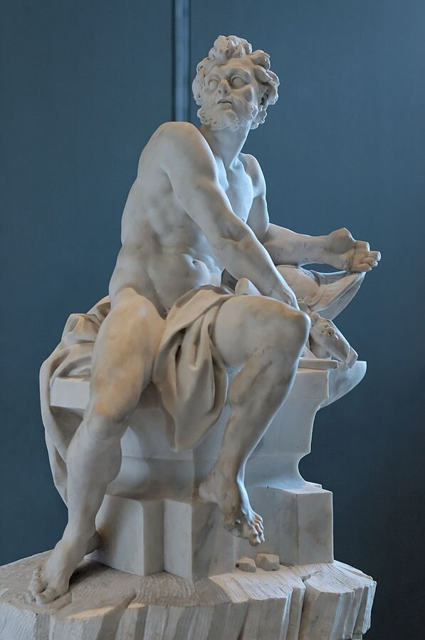 """Master blacksmith and craftsman of the gods; god of the forge, craftsmanship, invention, fire and volcanoes. The son of Hera, either by Zeus or through parthenogenesis. Married to Aphrodite. His Latin name, Vulcan, gave us the word """"volcano."""" His symbols include fire, anvil, axe, donkey, hammer, tongs, and quail."""