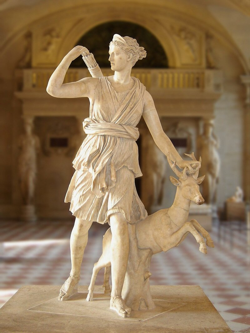 Goddess of the hunt, the wilderness, virginity, the Moon, archery, childbirth, protection and plague. The daughter of Zeus and Leto, and the twin sister of Apollo. Her symbols include the Moon, horse, deer, hound, she-bear, snake, cypress tree, and bow and arrow.