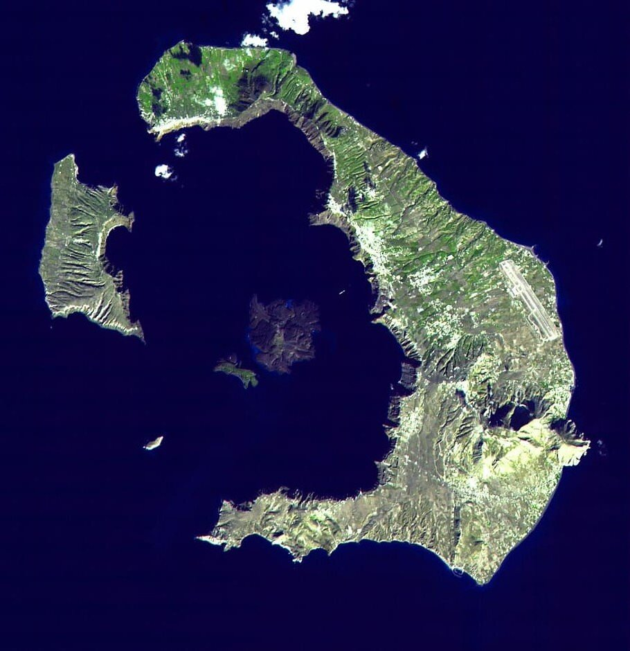 The island of Santorini (ancient name: Stronghili). The volcano which blew up 3,000 years ago was in the center of the caldera, with the explosion leaving only the outsides of the mountain extant, as we see today. Credit: px fuel/Satellite image