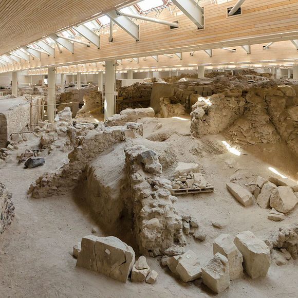 The  prehistoric settlement  of Akrotiri on the island of  Santorini  (Thíra) is one of the most important sites in the Aegean. In  prehistory  it was a well connected Minoan port town, with connections to mainland Greece and as far afield as Egypt and Syria.
