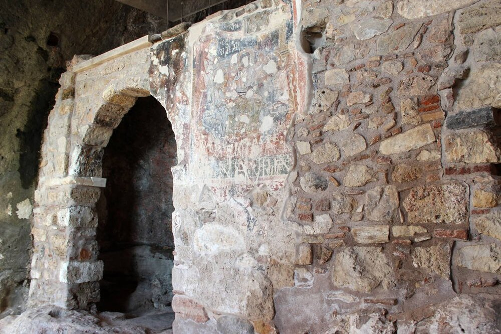 The north wall of Panagia Spiliotissa after the restoration of the arch opening and the preservation of the fresco decoration