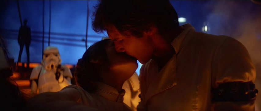 This a beautiful, tender moment- the warmth of passion clashes with the cold reality of their situation.