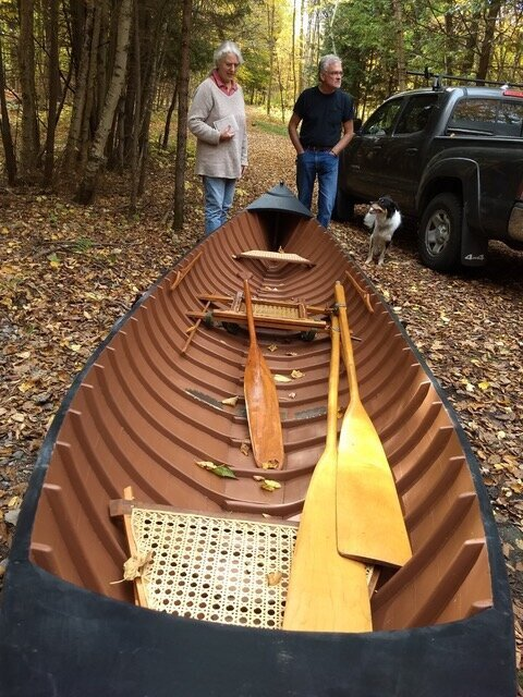 me seeing this beautiful adirondack guideboat, lovingly restored for caliban press proprietor mark mcmurray in cranberry lake, and my friend francis, at mark's side.