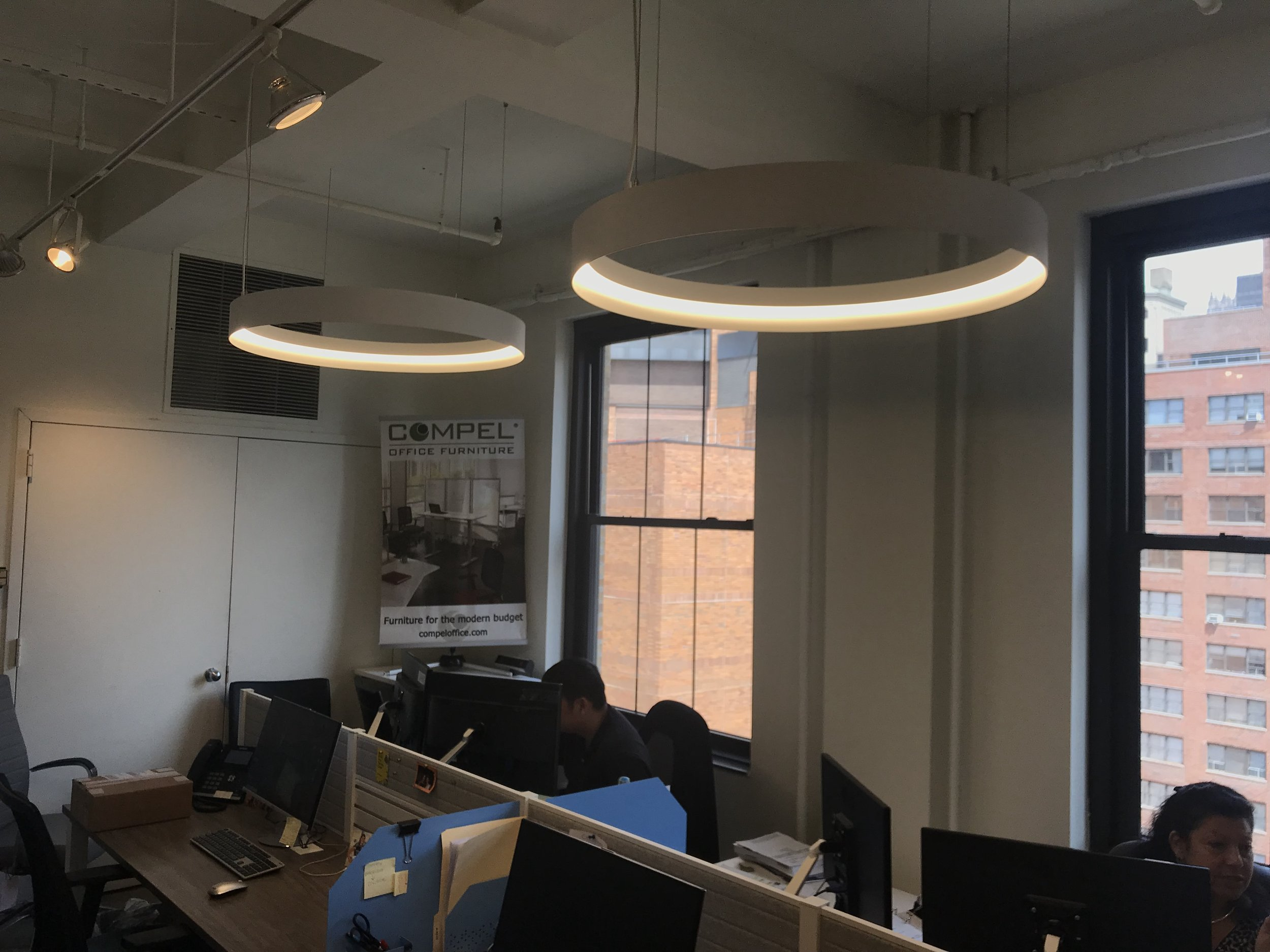 Right next to the Orion, the Gibson workspace also includes two Halo fixtures. These fixtures give the office a very futuristic feel when you see them. They are beautiful open rings of light who's colors will add a fascinating pop to your space.