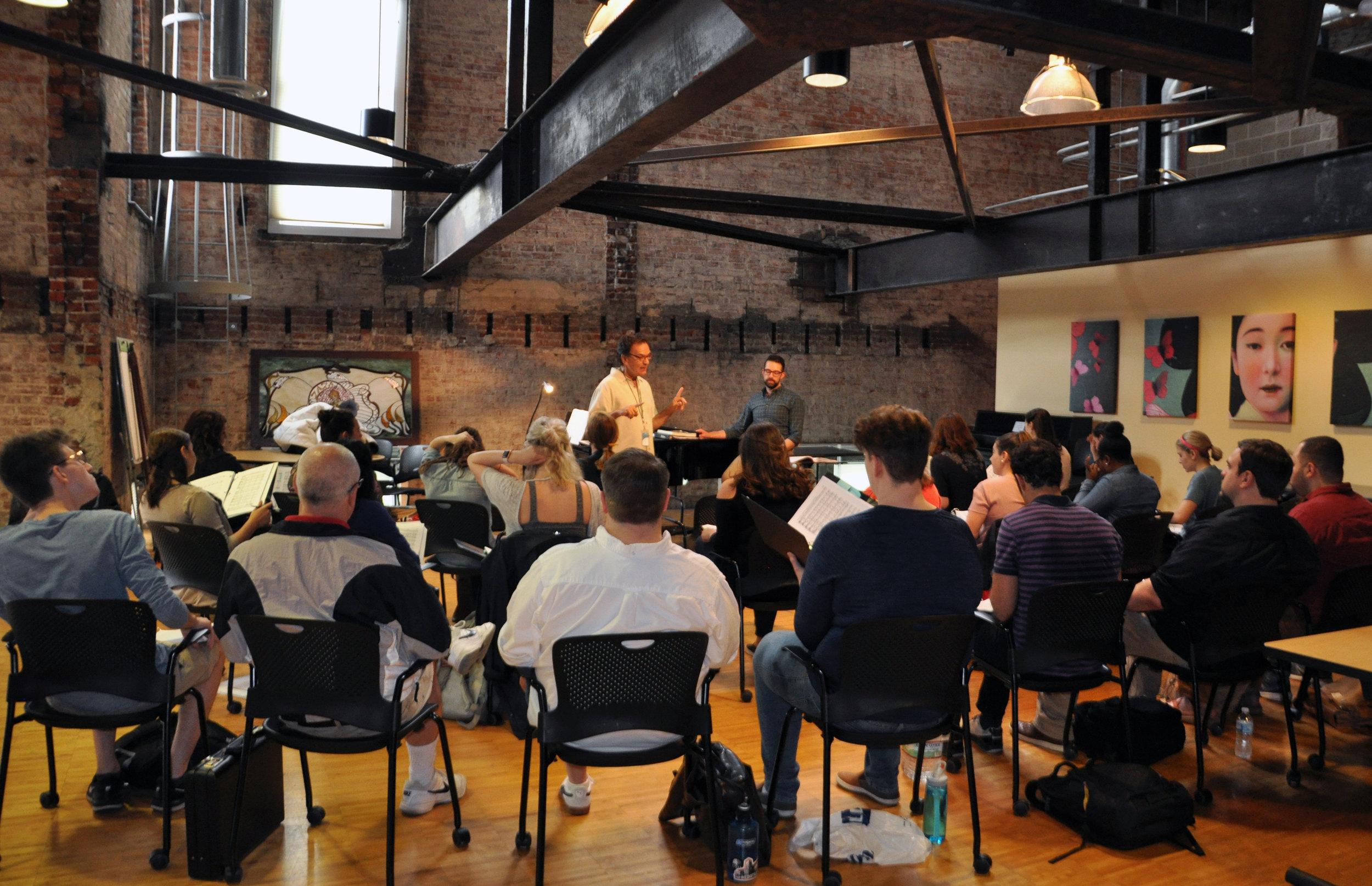 Chorus Master Henri Venanzi leads the chorus rehearsal for  La Traviata