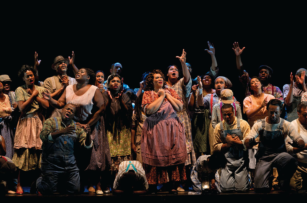Photo: The residents of Catfish Row pray for safety from the approaching hurricane in our 2012 production of  Porgy and Bess . Photo by Philip Groshong.