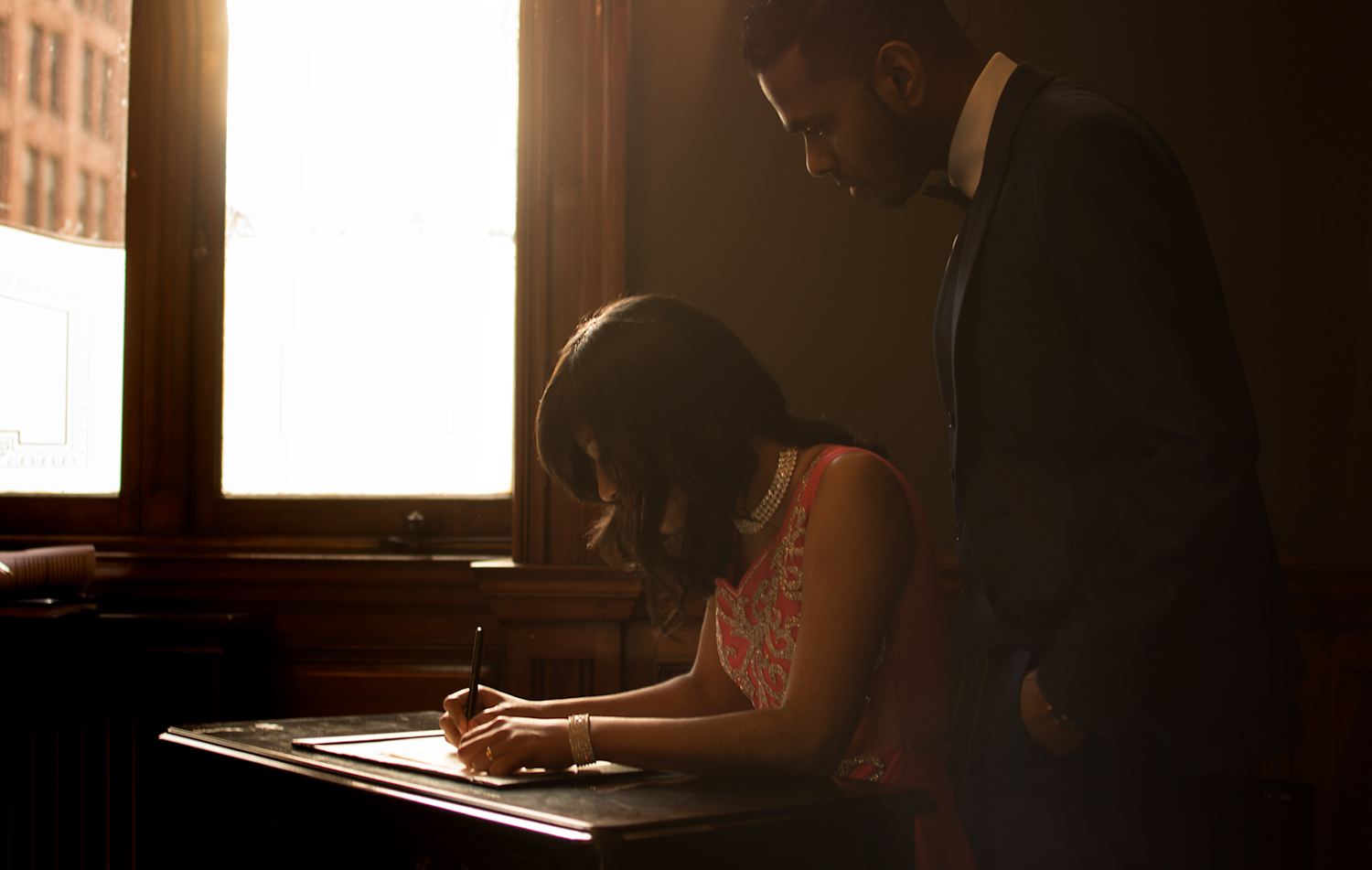chris-wallace-wedding-photography-glasgow-scotland-montrose-street-registry-office-clyde-suite-backlight-signing-of-the-registar-singed-sealed-delivered-1500.jpg