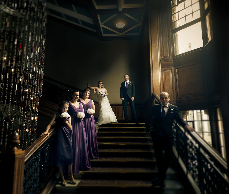 chris-wallace-wedding-photography-glasgow-grand-central-hotel-chandelier-starcase-scotland-vanity-fair-style-groupshot.jpg