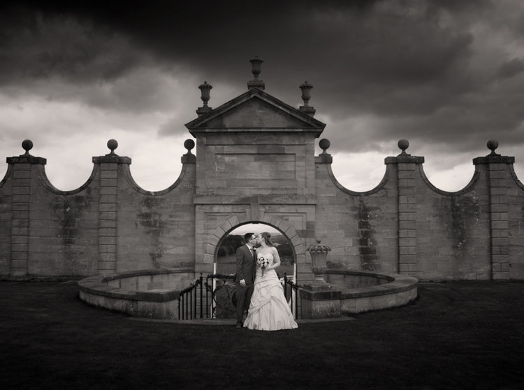 chatelherault-weddings-dramatic-sky-kiss-chris-wallace-photography-.jpg