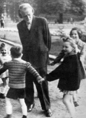 (Zoltán Kodály, playing with his children)