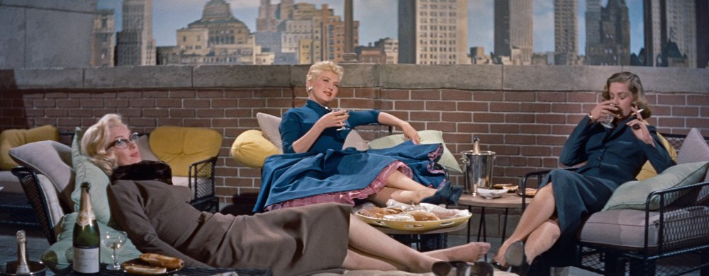 how-to-marry-a-millionaire-1953-002-marilyn-monroe-betty-grable-lauren-bacall-sitting-balcony.jpg