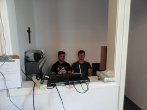 The youth help out in the sound room making sure it comes through perfect. Thank you Hayden and Sam.