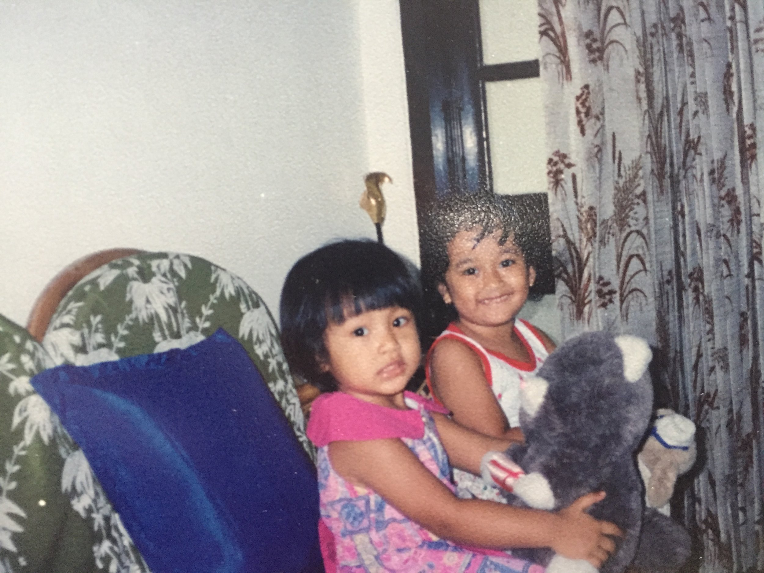 22 years ago with my cousin. I was so cute. Super kawaii. My face changed so much.