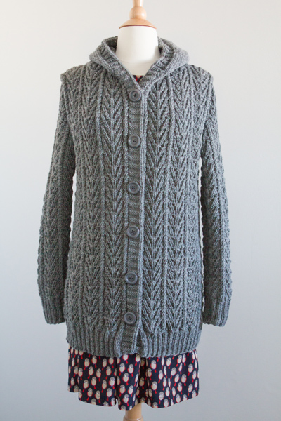 The pattern in the book was a pull-over sweater, so I added button bands to have a front opening, lengthened, and added a hood.
