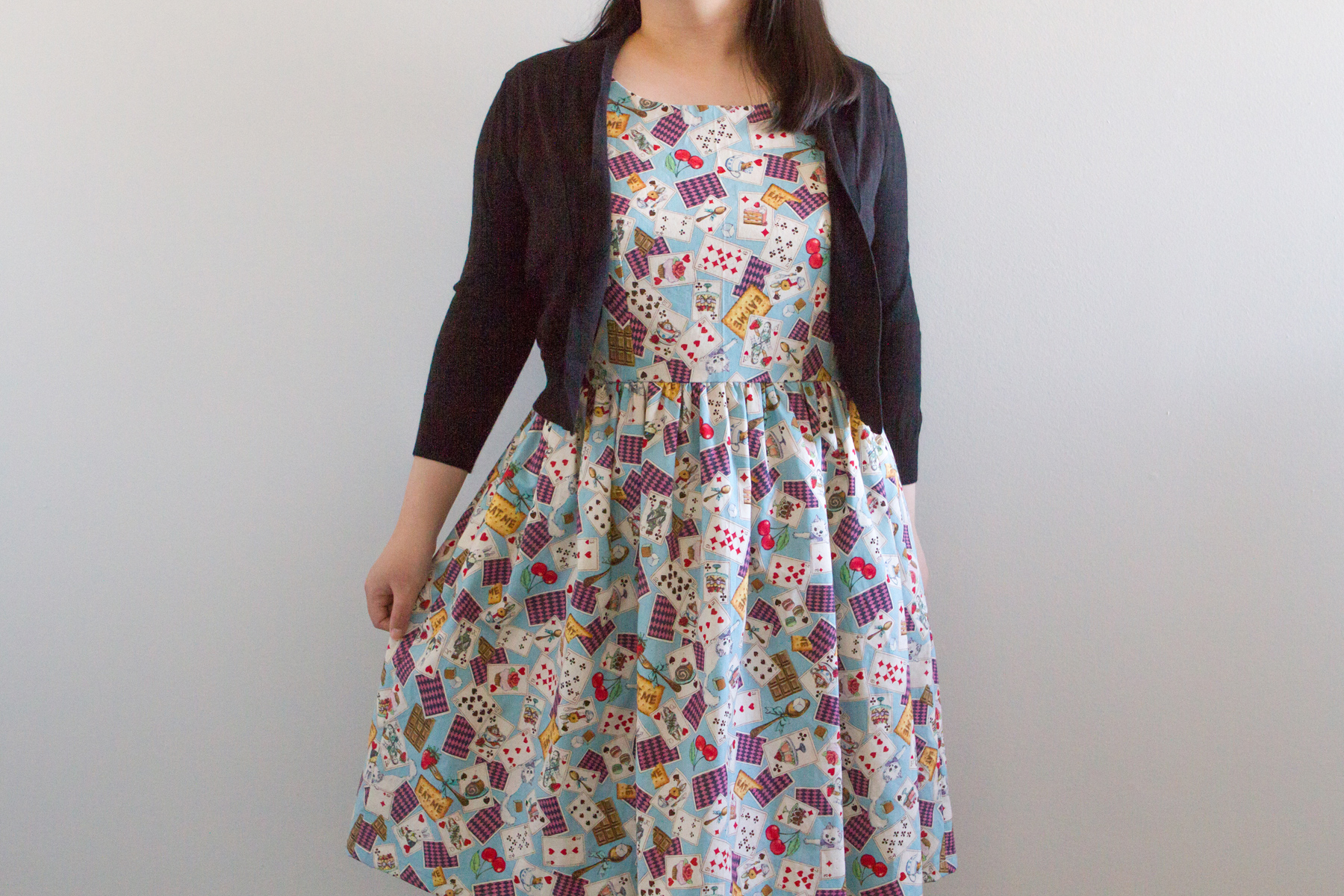 I think a beige cardigan would go better with this dress, I need to get one!