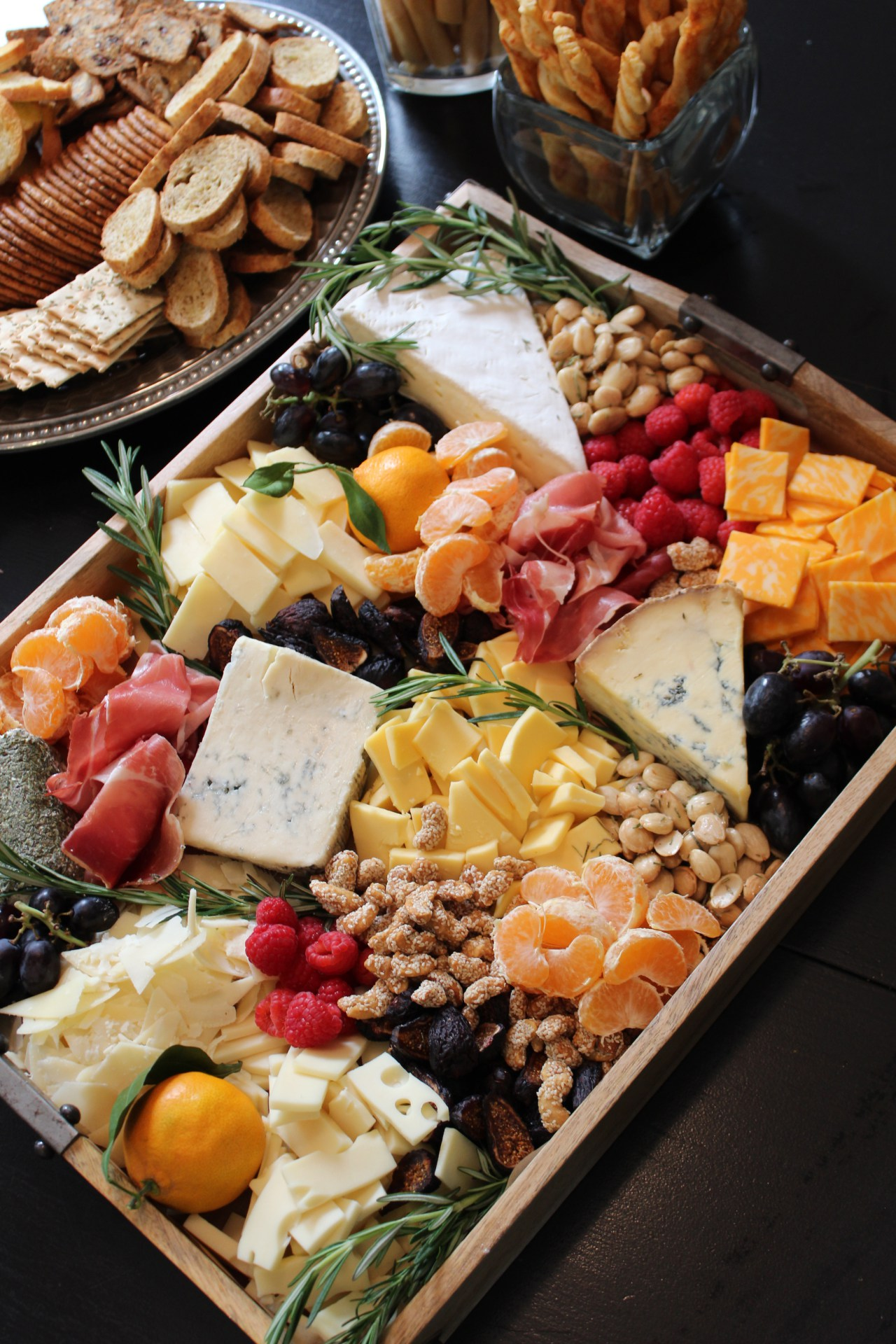 Cheese board - this is always a party favorite. The mixture of the cheese, fruit, nuts, and meat gives a little something for everyone.
