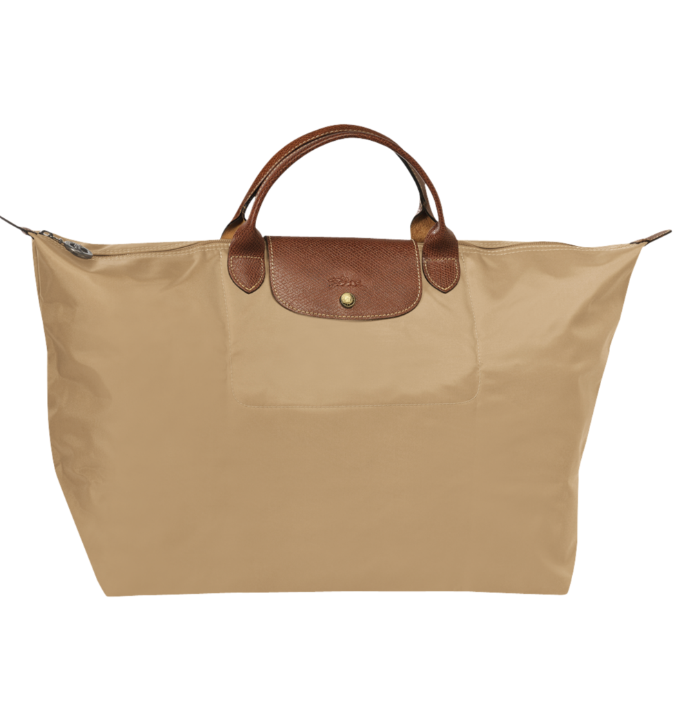 Duffel - Longchamp duffel bags have always been so cute to me. Plus, the fabric makes them perfect for easy cleaning after traveling.