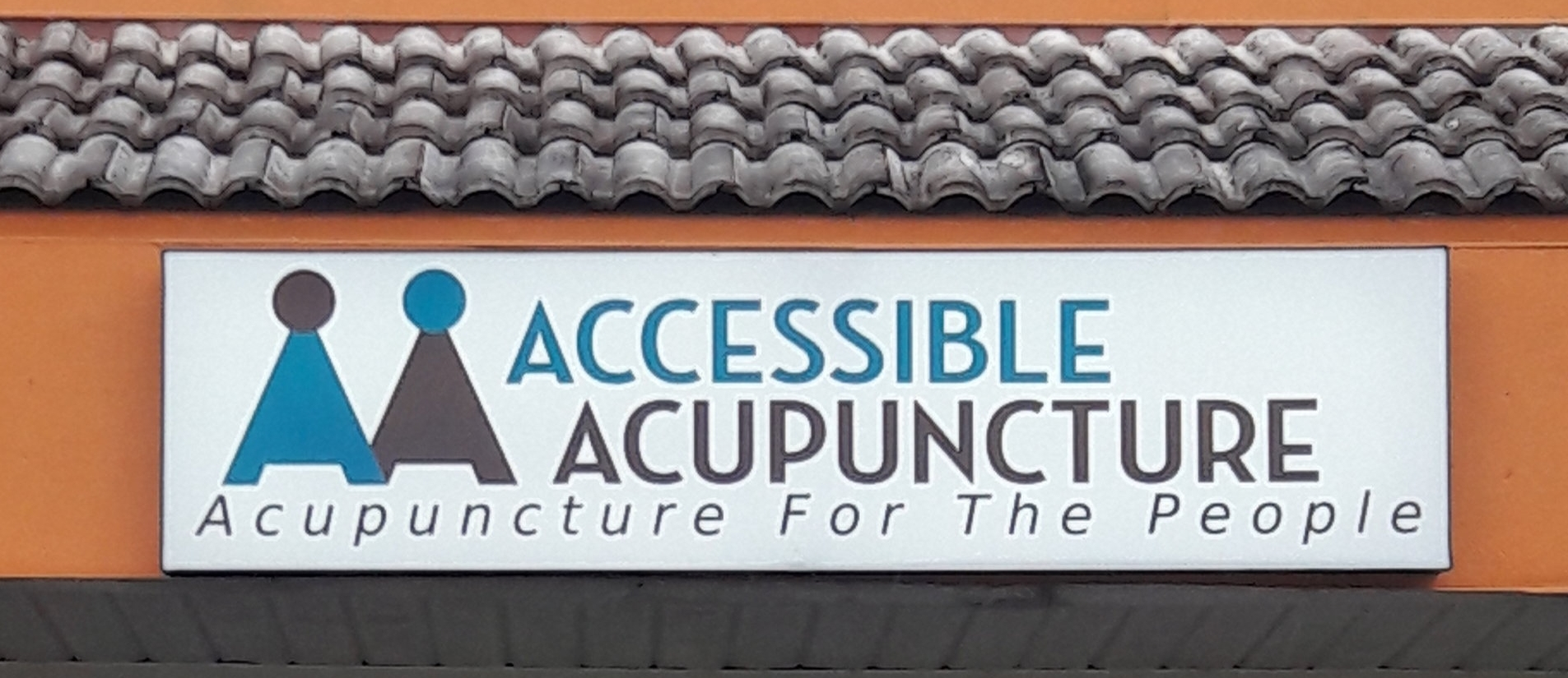 Sign above our storefront entrance