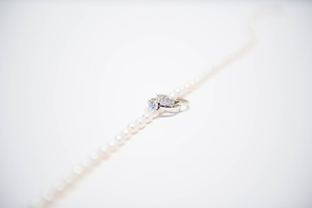 Wedding band and engagement ring with pearl necklace.  wedding day details - www.lisavillellaphotography.com