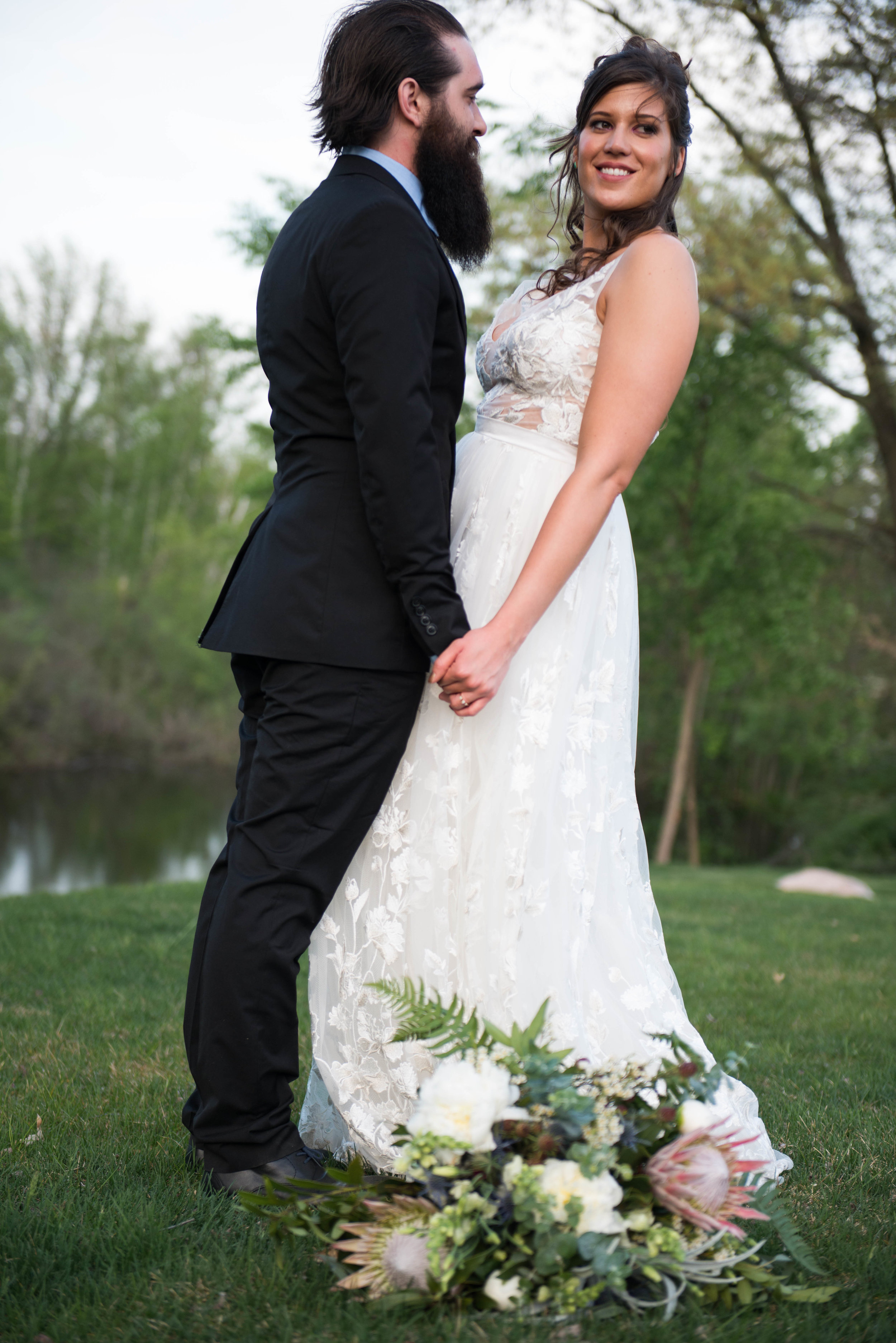 Gown by Detroit Bridal House and bouquet was created by Lasting Touch Floral. www.lisavillellaphotography.com