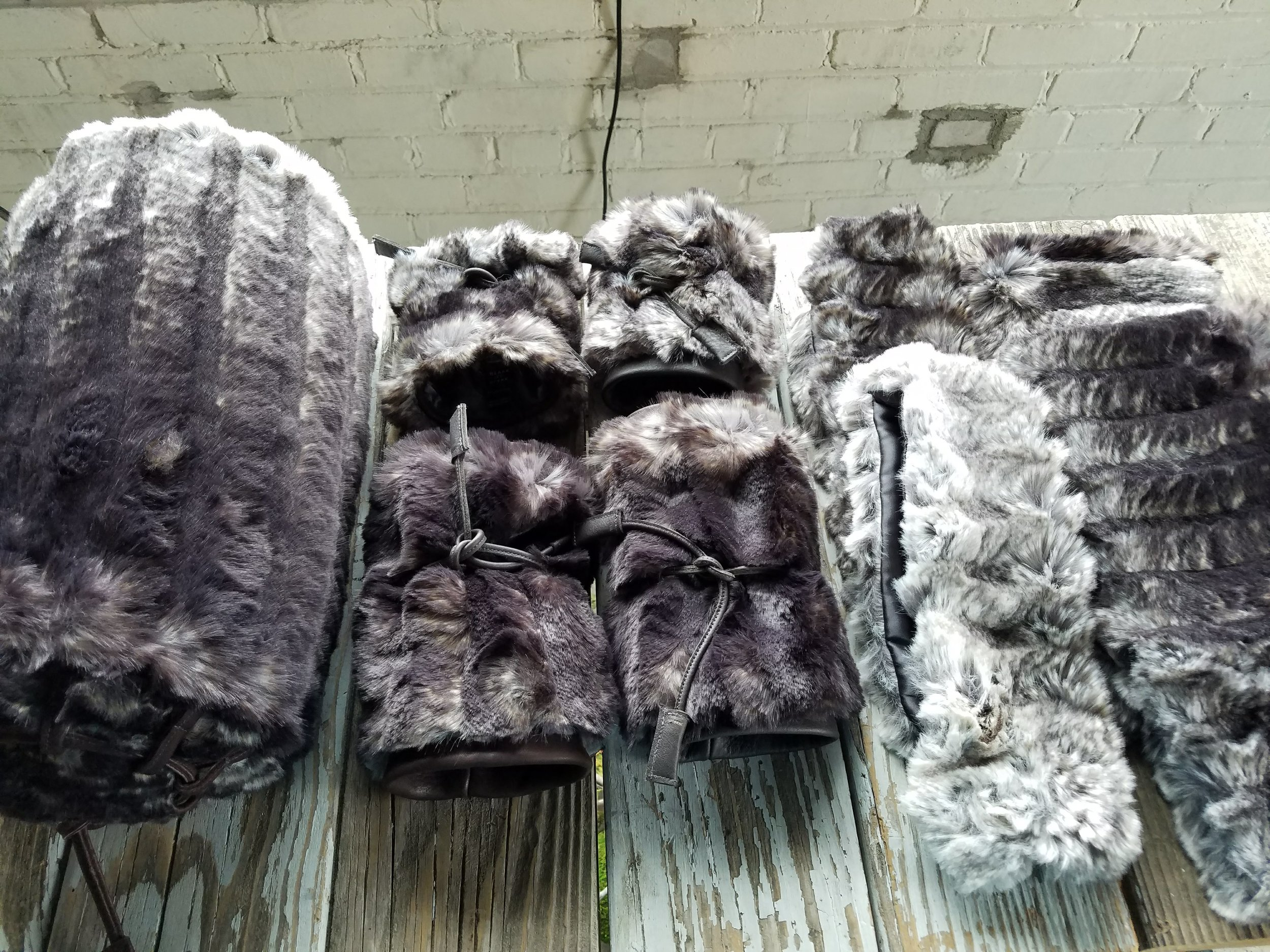 Warm and stylish looks from BLANK ITTI BLANK; pillows, fur cuffs, head wrap, muffs.