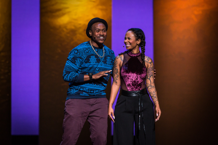 Tiq and Kim Milan on stage at TED