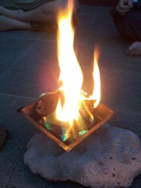 Burning Agnihotra Fire in sacred copper pyramid vessel