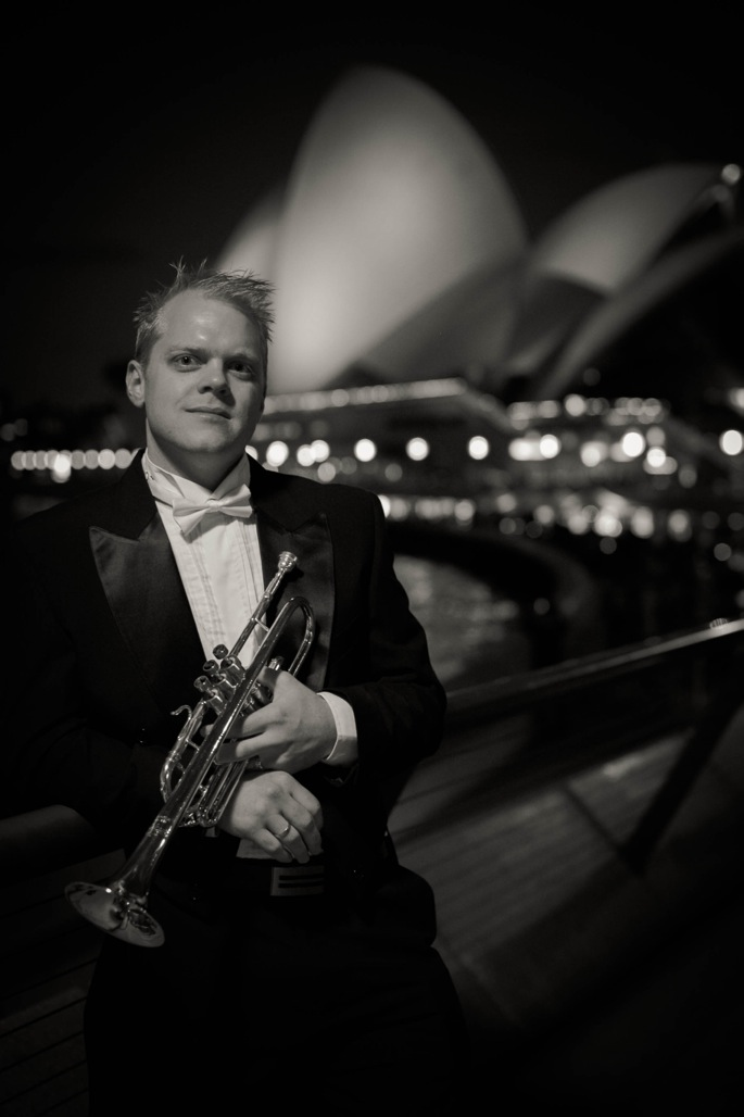 Trumpeter Phill O'Neill in front of the Sydney Opera House