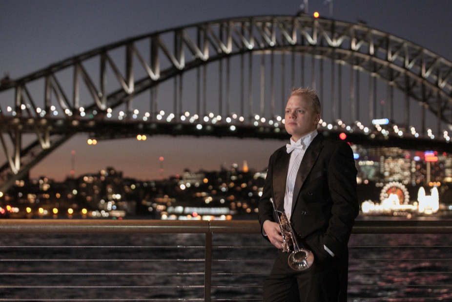 Trumpeter Phill O'Neill in front of the Sydney Harbour Bridge