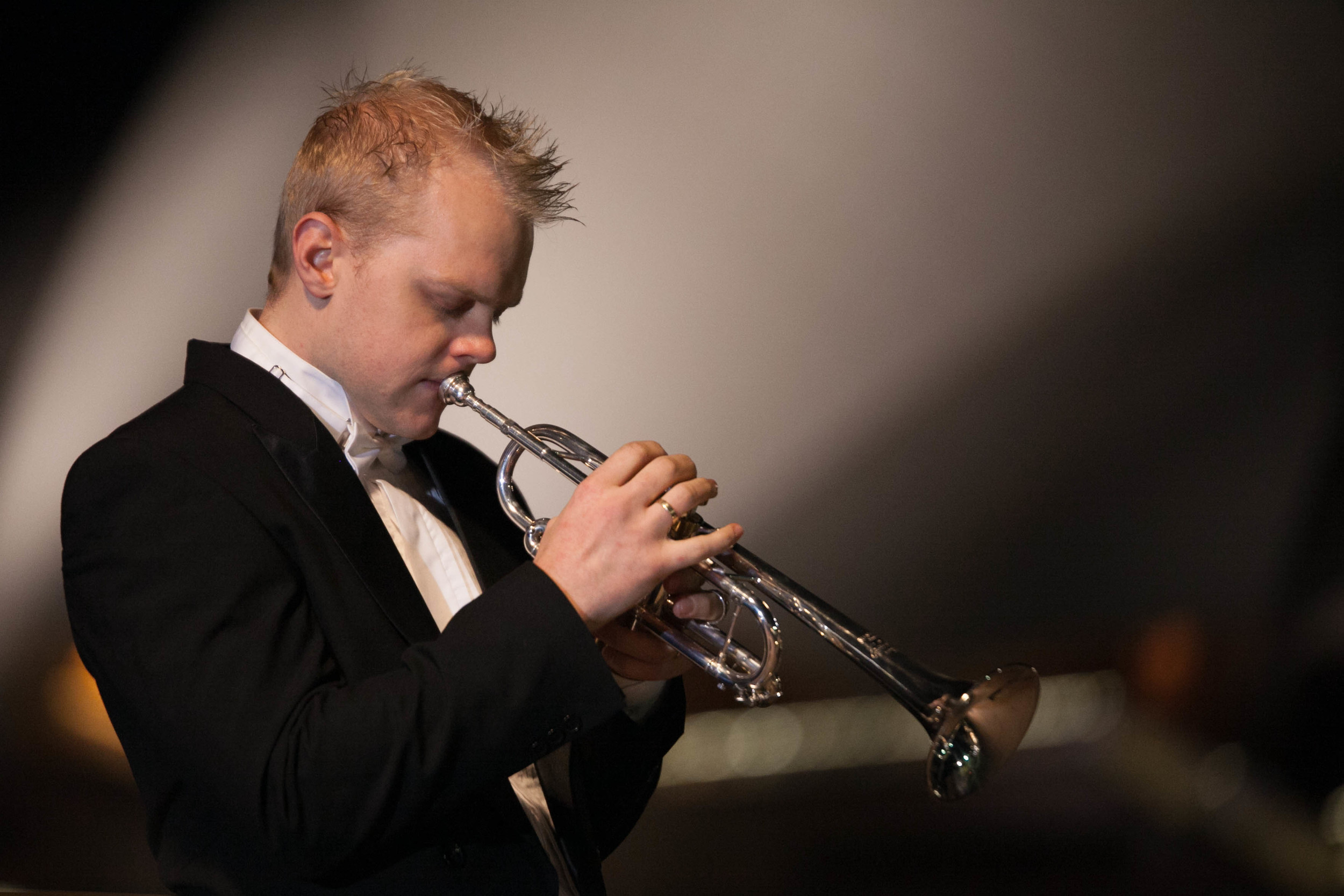 Phill O'Neill Trumpet player in front of the Sydney Opera House