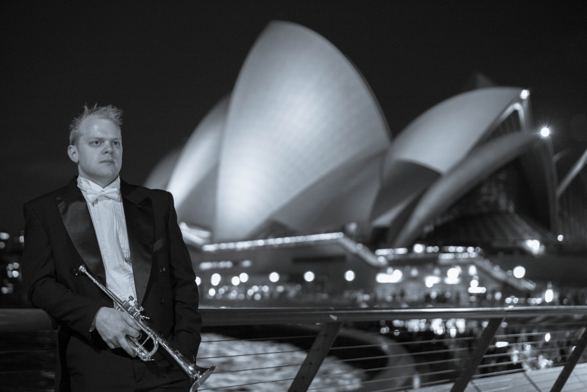 Phill O'Neill Trumpeter player in front of the Sydney Opera House