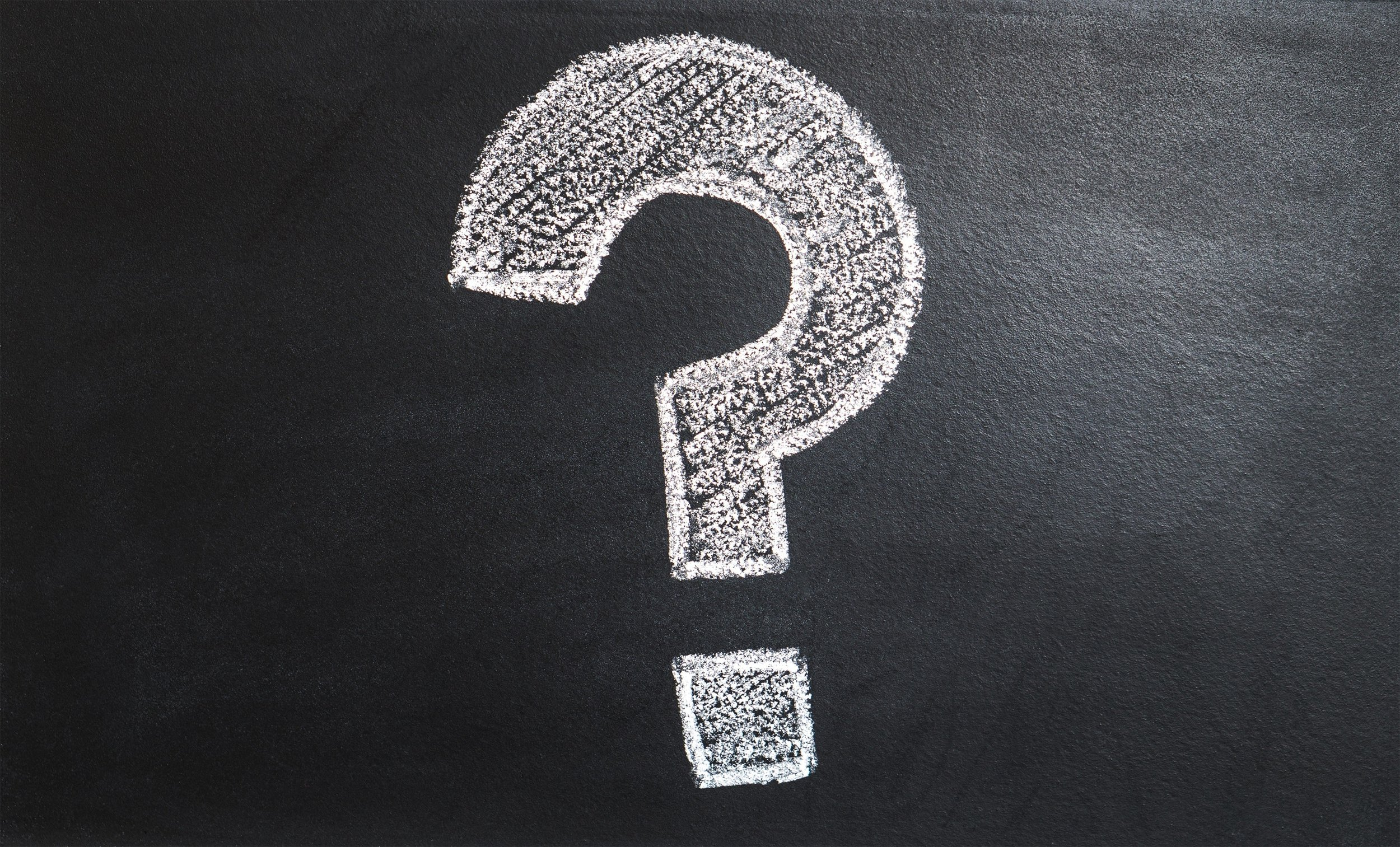 The Image above is a picture of a question mark drawn onto a blackboard.