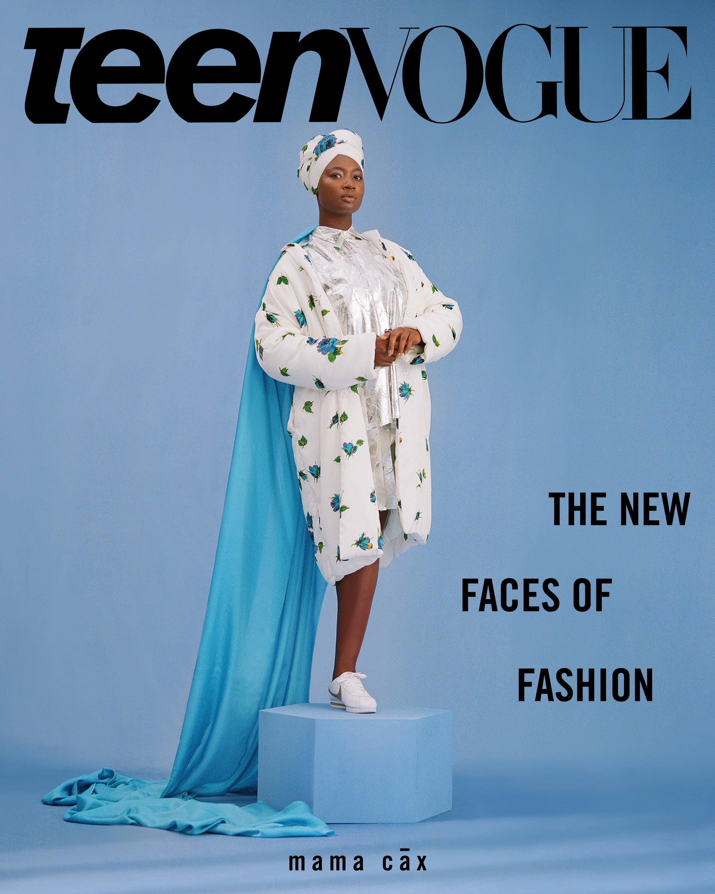 """Mama Cax was also featured in TeenVogue's September issue. In the cover she is wearing a white turban, a white floral jacket and has a large blue cape flowing behind her while she stands on a blue box. Behind her the caption reads: """"The New Faces of Fashion"""" - referring to the other models with disabilities that the magazine has featured in their September issue."""
