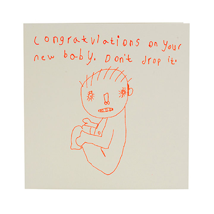 """The card shows a picture of a baby with the words: """"Congratulations on your new baby. Don't drop it."""""""
