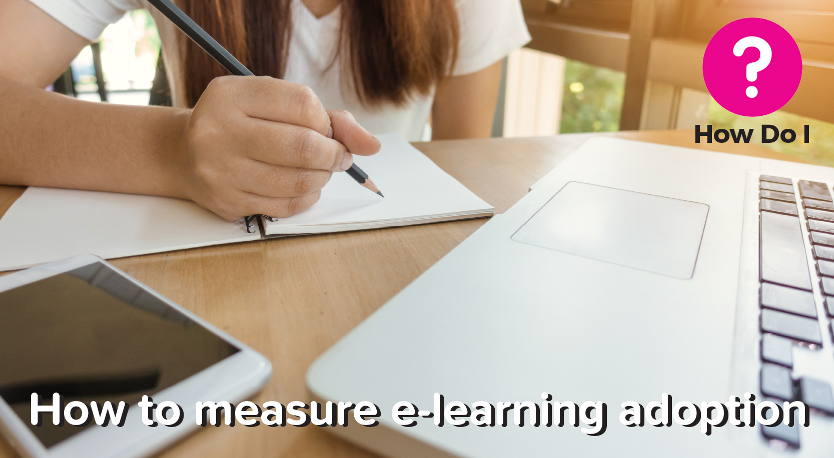 How to measure e-learning adoption banner - pictured in the background is a colleague taking an e-learning course, as they are sat at a computer with a pen and notebook in hand.