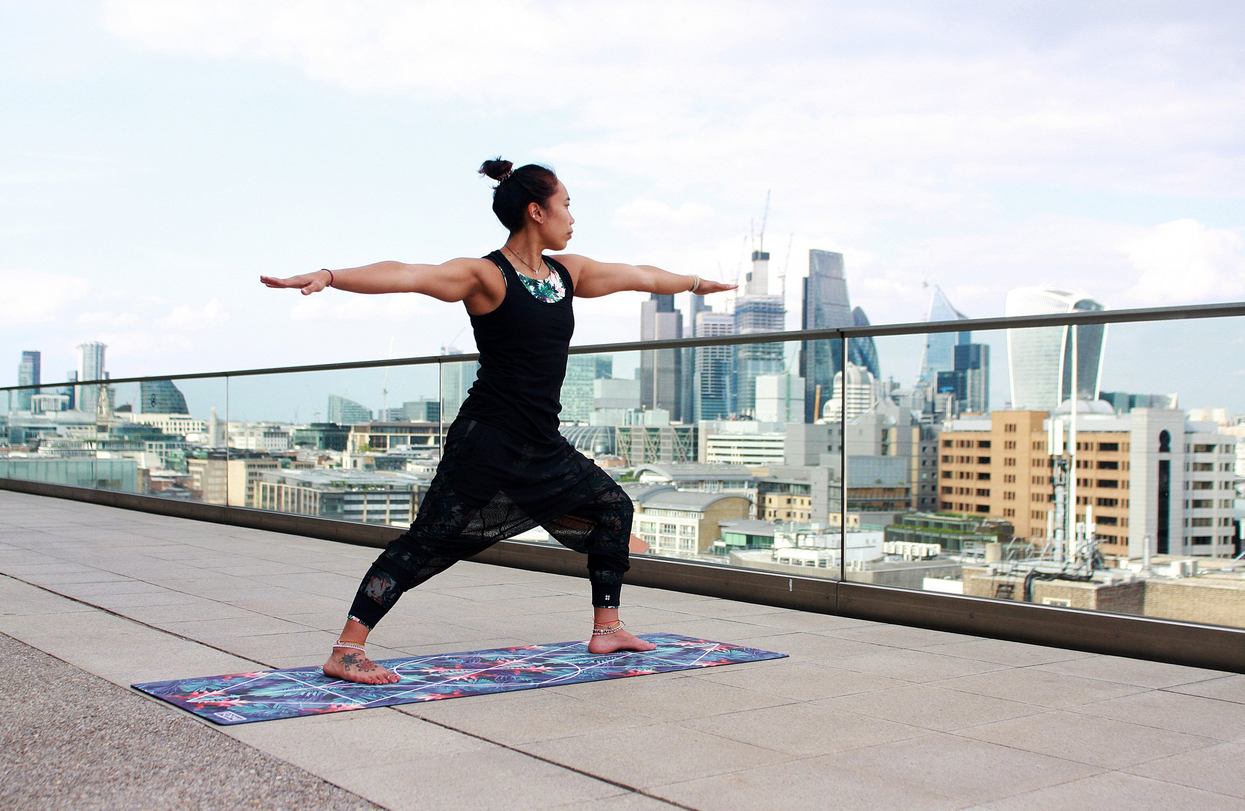 An office worker practising yoga on the roof of the workplace's building.