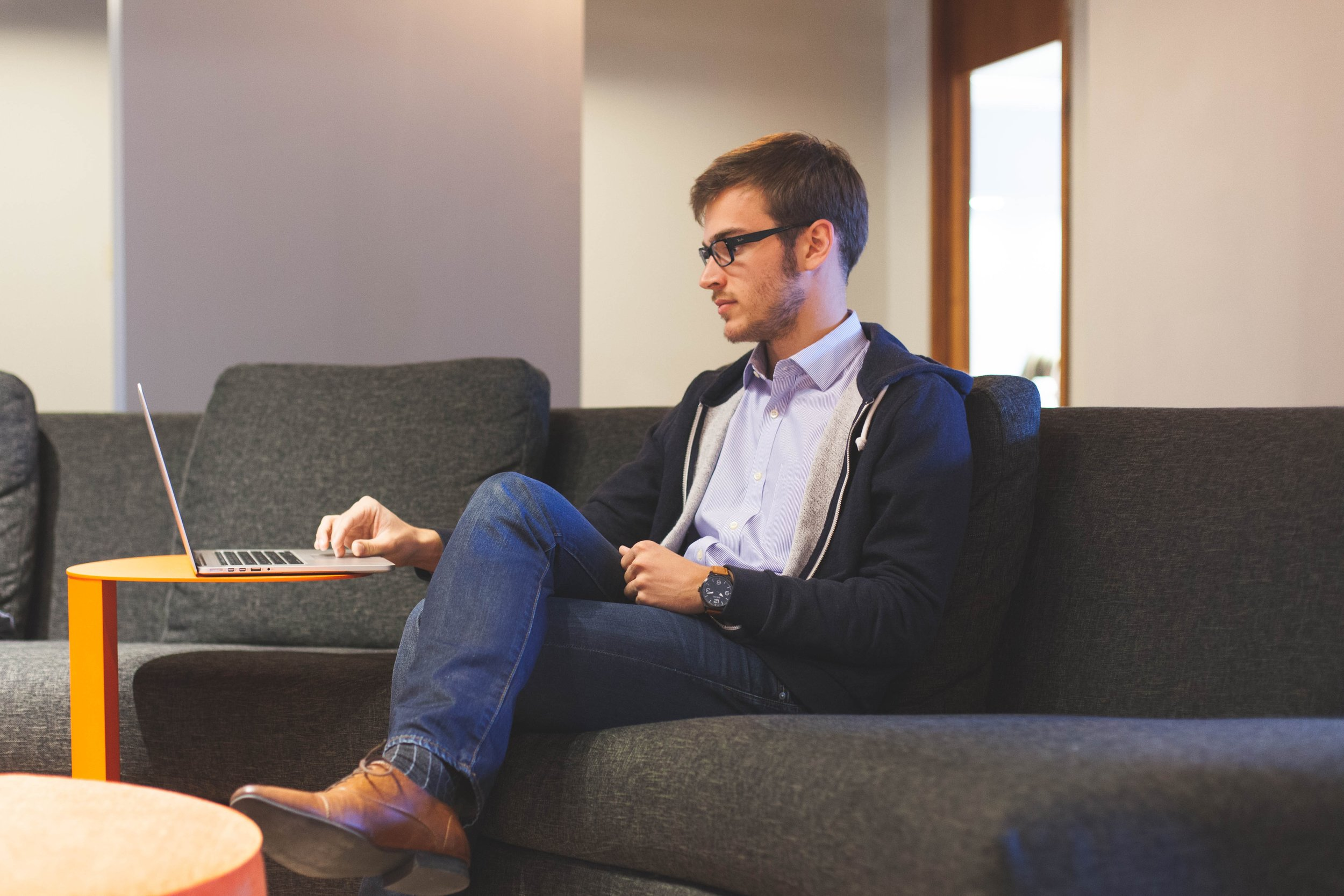 Steve is pictured sitting in the office lounge and is catching on the workshop he missed by completing the online course.
