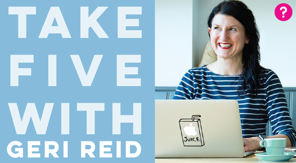Take Five With Geri Reid - Geri is sitting at a desk with her laptop and a cup of coffee, and is smiling into the distance. On her MacBook is a sticker of a juice carton, which she has cleverly placed over the apple icon so it says 'apple juice'.
