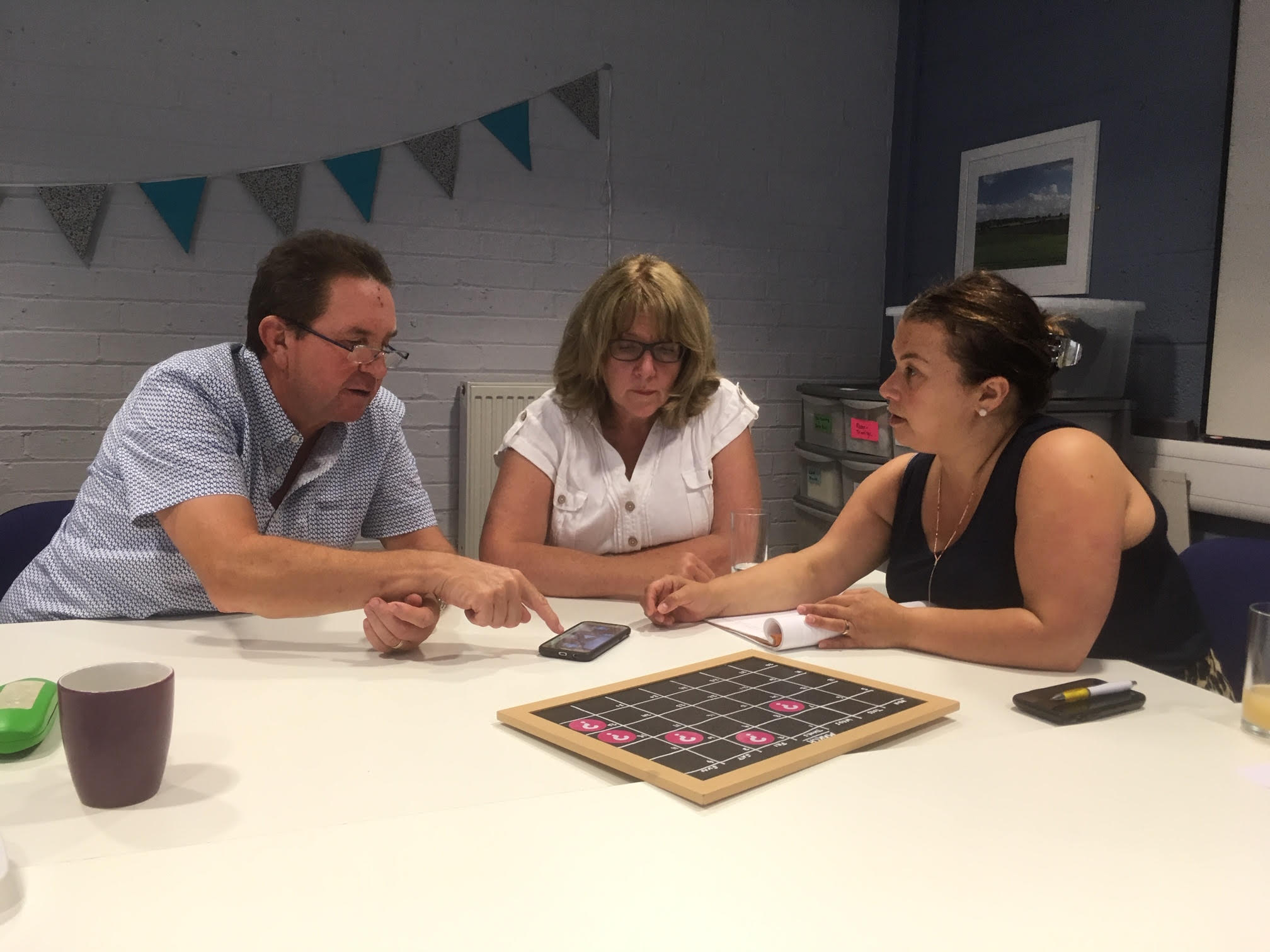 Two volunteers from the Dementia Voice Network, pictured with Taryl, giving their thoughts and feedback on our technology.