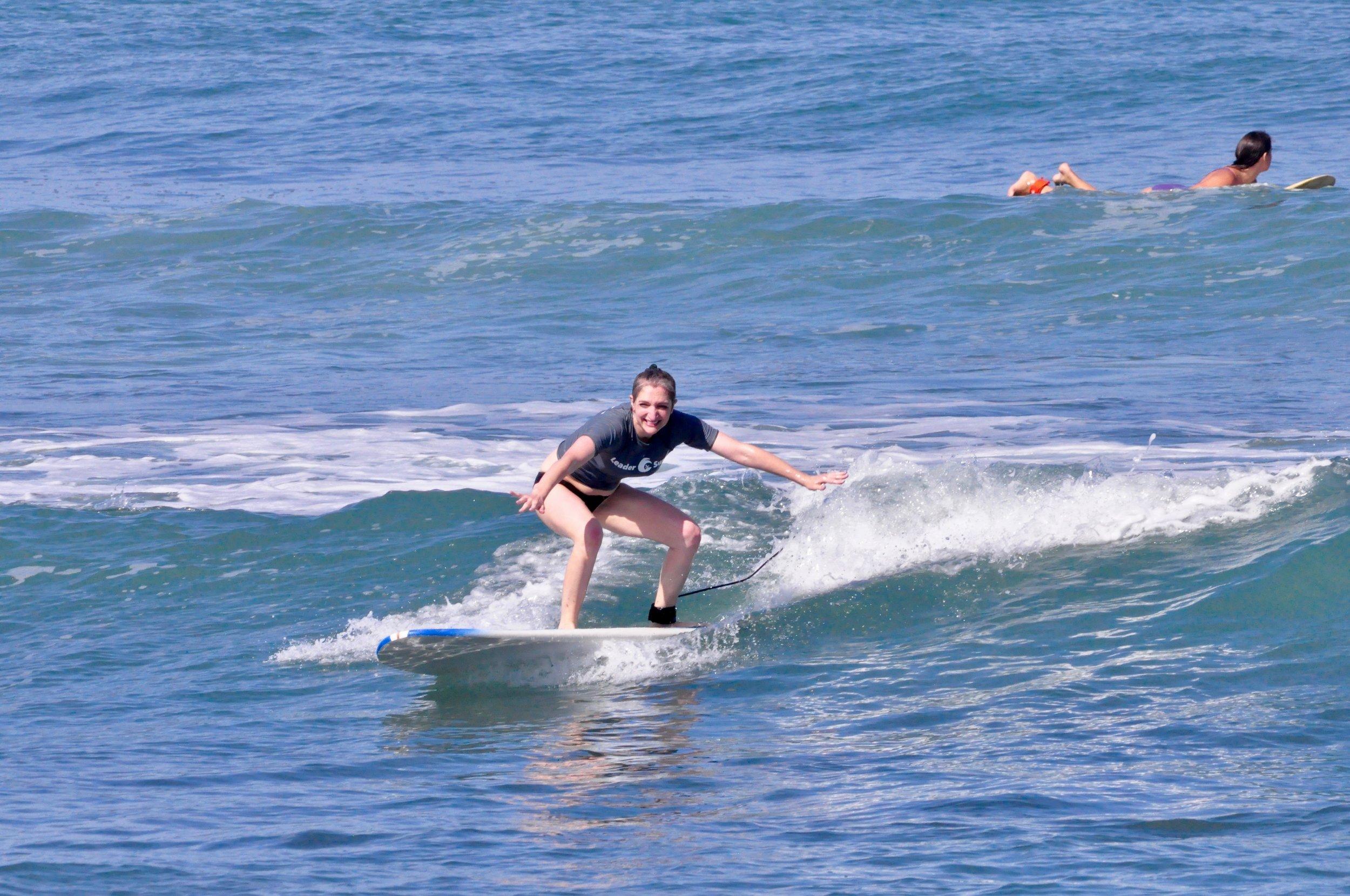 Ally riding a wave