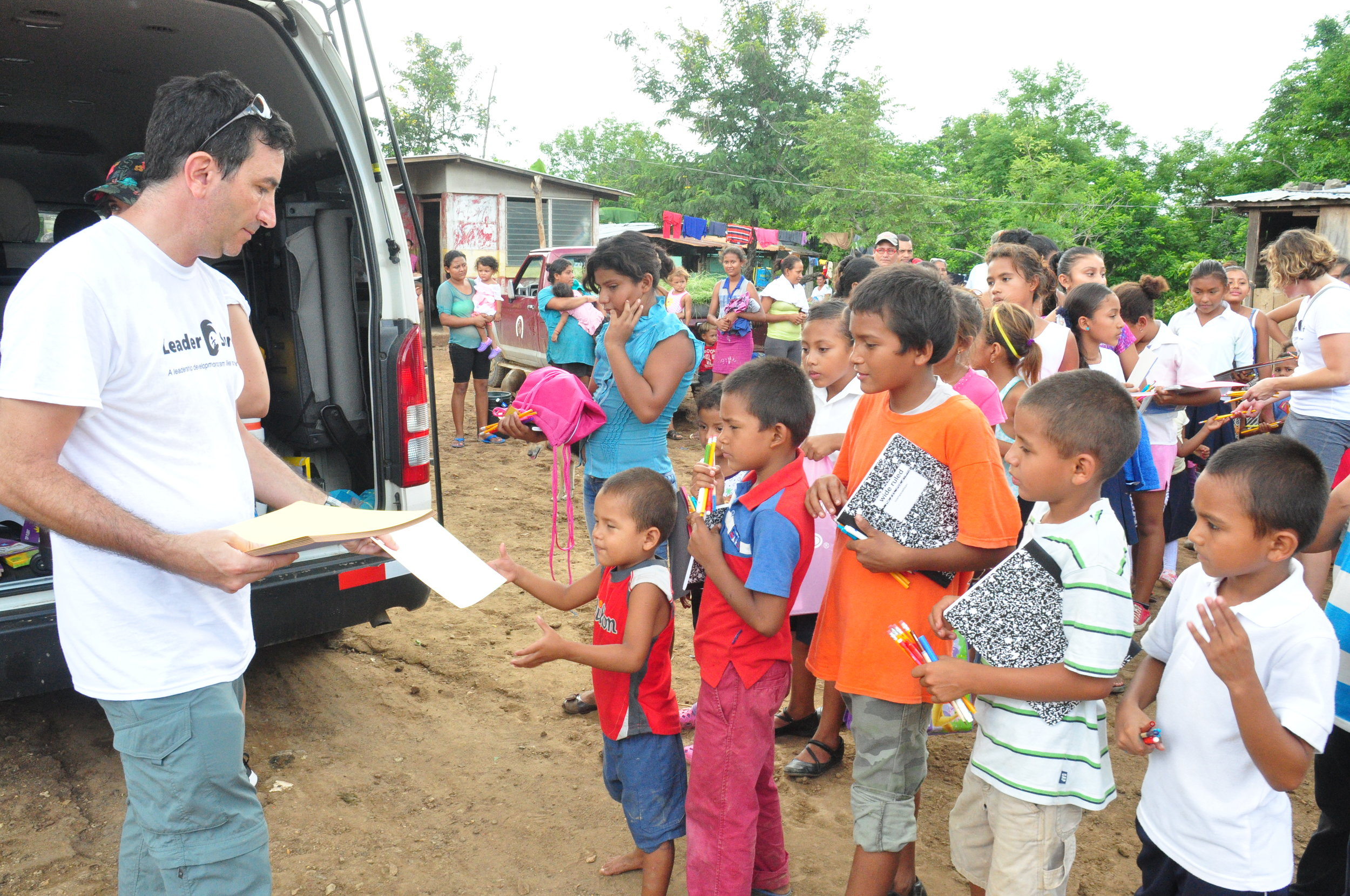 Handing out school supplies to children in need